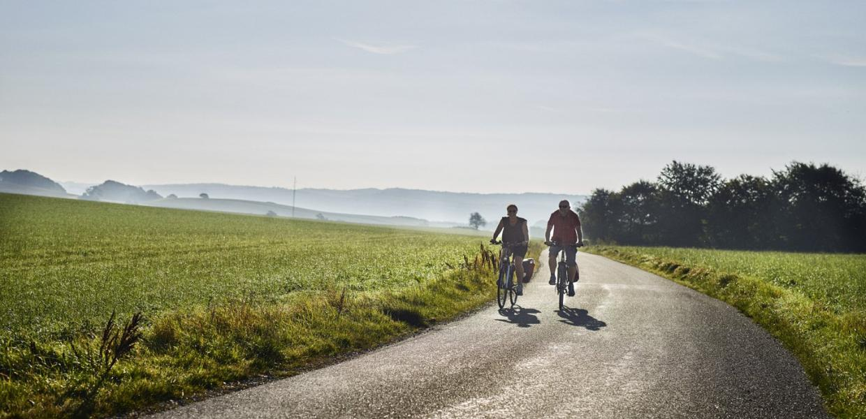 Couple biking in Djursland