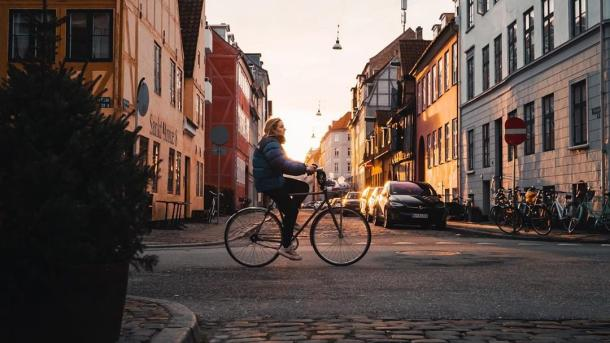 Girl biking in Christianshavn, Copenhagen
