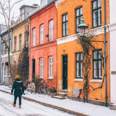 Colourful terraced houses in Copenhagen in winter, snow on the ground