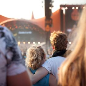 Couple in front of Orange Stage at Roskilde Festival
