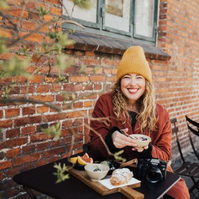 A woman having breakfast outside in Copenhagen, Denmark
